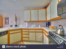 white kitchen cabinets wood trim wood trim cabinets high resolution stock photography and