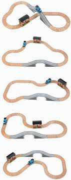 thomas train table amazon amazon com thomas wooden railway 5 in 1 up and around set toys