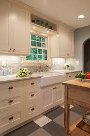 white kitchen cabinets with glass cup pulls transitional kitchen fiddlehead design kitchen