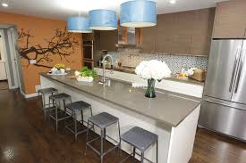 open galley kitchen with long center island by kitchen cousins