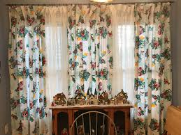 this my pioneer woman canisters they were just a little short so the pioneer woman tablecloths that i turned into curtains