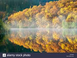 reflection in lake britton with fall colored trees california