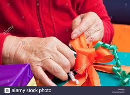 senior citizen gifts senior citizen wrap or unpack gifts closeup stock photo