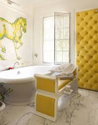 yellow bathroom decor ideas with horse wall art and white bathtub