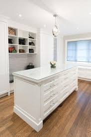 glass top closet island with 12 drawers transitional closet