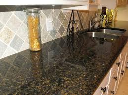 ubatuba granite this gray and gold backsplash goes really well