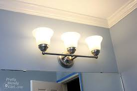 Changing Out A Light Fixture Bye Bye Hollywood Strip Light Light Fixtures For Bathroom Vanity
