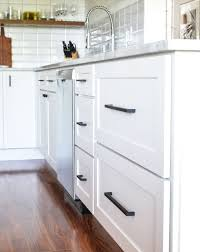 white kitchen cabinets with black drawer pulls kitchen drawer pulls