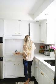 painting kitchen cabinets from wood to white how i refreshed my kitchen cabinets in one afternoon a
