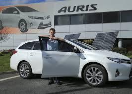 a toyota race driver anthony davidson buys a toyota auris hybrid