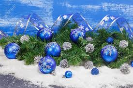 blue christmas decorations and silver pine cones background