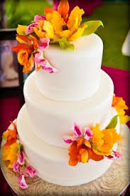 white tiered cake with amazing tropical flowers hawaii wedding