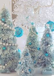 snow covered aqua blue bottle brush tree pearl garland