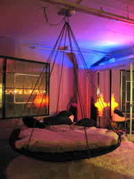 Hanging Canopies by Floating Round Hanging Bed With Chains And Fabulous Lighting