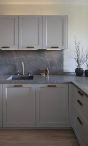 light gray kitchen cabinets with marble countertops 25 timeless and chic marble kitchen backsplashes shelterness
