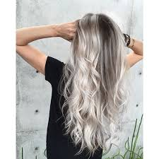 platinum hairstyles with some brown platinum blonde and smoky hair color long hair long curly hair