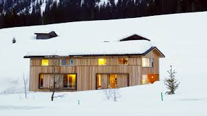 snow proofed hillside family home in austria alpine modern
