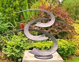 decorate your garden with impressive garden sculpture designs 17