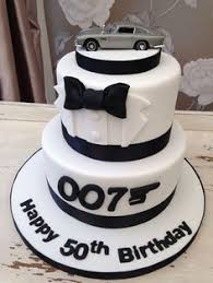 007 70th birthday cake by customcakedesigns deviantart com on