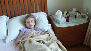 sick bed portrait sick girl 7 years old lying on a bed and measures the