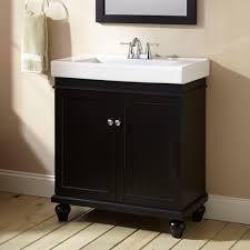 bathroom black bathroom vanity with brown wooden floor and brown