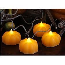 led pumpkin tea lights led flameless real wax 4 pack mini pumpkin votives tealights
