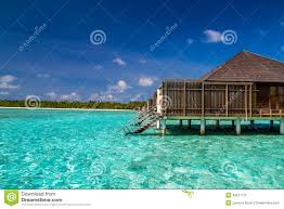 wonderful tropical beach with water bungalows in maldives stock