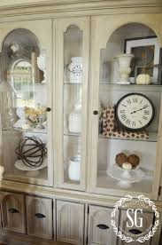how to decorate your china cabinet 5 easy tips to style a hutch living room styles easy tricks and
