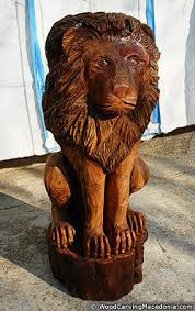wooden animal sculptures statues company logo photos chainsaw