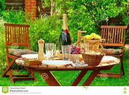 outdoor lunch table with bottle of wine on the backyard stock