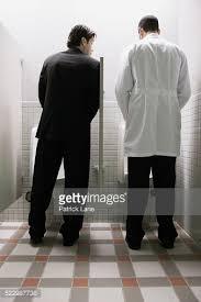 bathroom men men using urinals in public bathroom stock photo getty images
