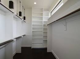 contemporary closet with concrete floors by significantbuildings