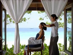 a head massage at the como shambhala retreat in cocoa island
