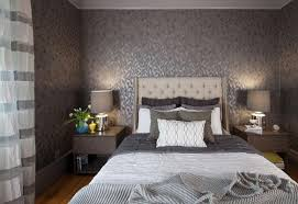 a glamorous grey bedroom with patterned wallpaper and lavish