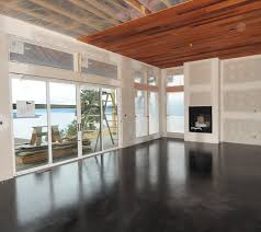 a modern black stained concrete floor created by mode concrete in