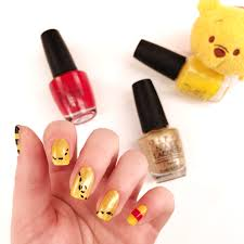 winnie the pooh nail art that is sweet as hunny
