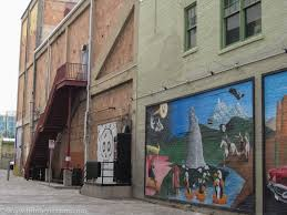 discovering historic downtown tucson thirdeyemom many murals depict themes of tucson s early heritage this one below shows a native american up against presumably a spanish invader