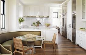 open kitchen in white with diner style curved banquette bench