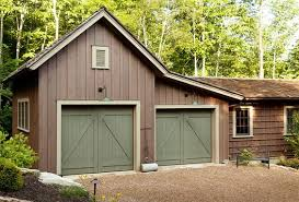 the barn inspired garage attaches to the main house via a enclosed