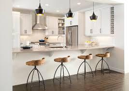kitchen dark triple hanging lamp above nice kitchen counter stools