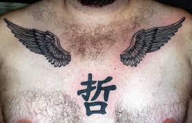 small black ink wings and hieroglyph on