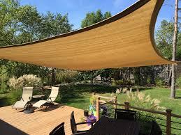 improve your backyard install a shade sail