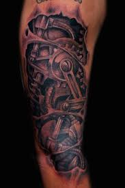 25 amazing biomechanical tattoos design