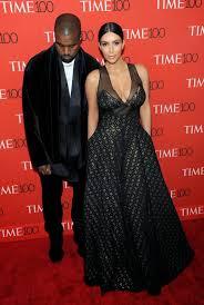 kim kardashian bares cleavage alongside kanye west at the 2015