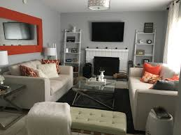 grey and orange living room paint by behr silver bullet in semi