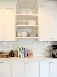 cloud white cabinets light gray grout white subway tiles open