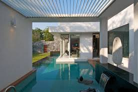 swimming pool in the backyard home garden with waterfall and white