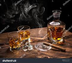 whiskey photography glasses whiskey smoking cigar ice cubes stock photo 393410869