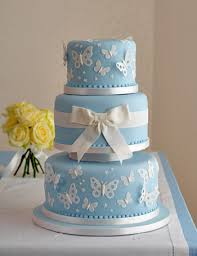 tiffany blue and white cake with a butterfly theme butterfly