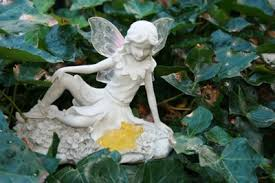fern garden ornament with solar light up wings and rabbit